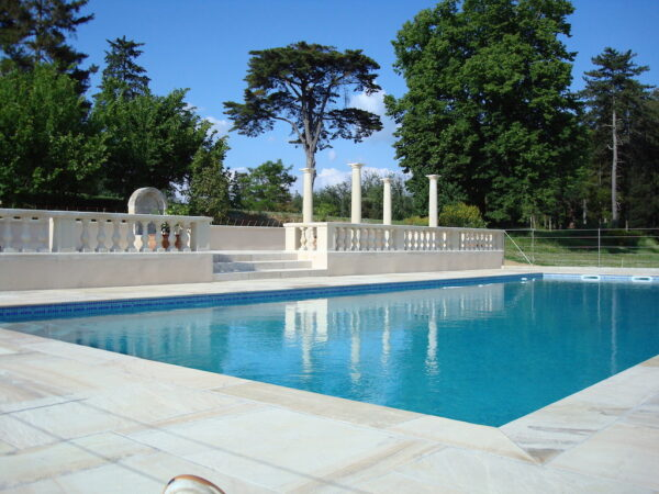 Balustrading creating a terrace area around a pool in France