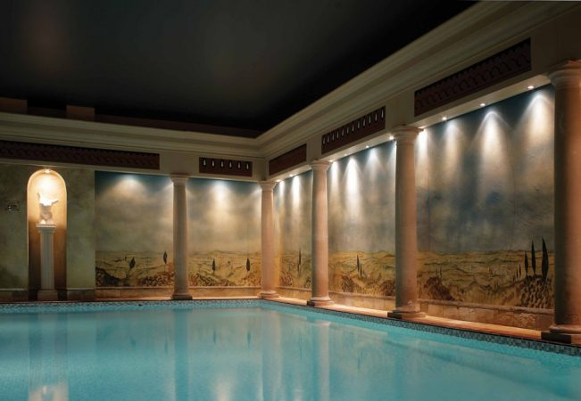 A pool room with columns