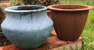 Rusty Norman Planter and weather beaten Copper Bell Jar