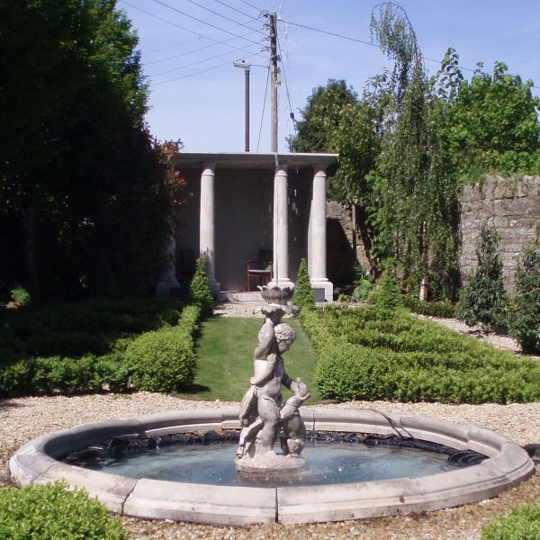 Child with dog fountain