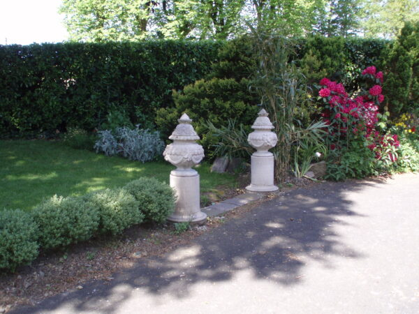 Ribbon urns mark an entrance Simonstown Architectural & Garden Ornaments agents for Chilstone
